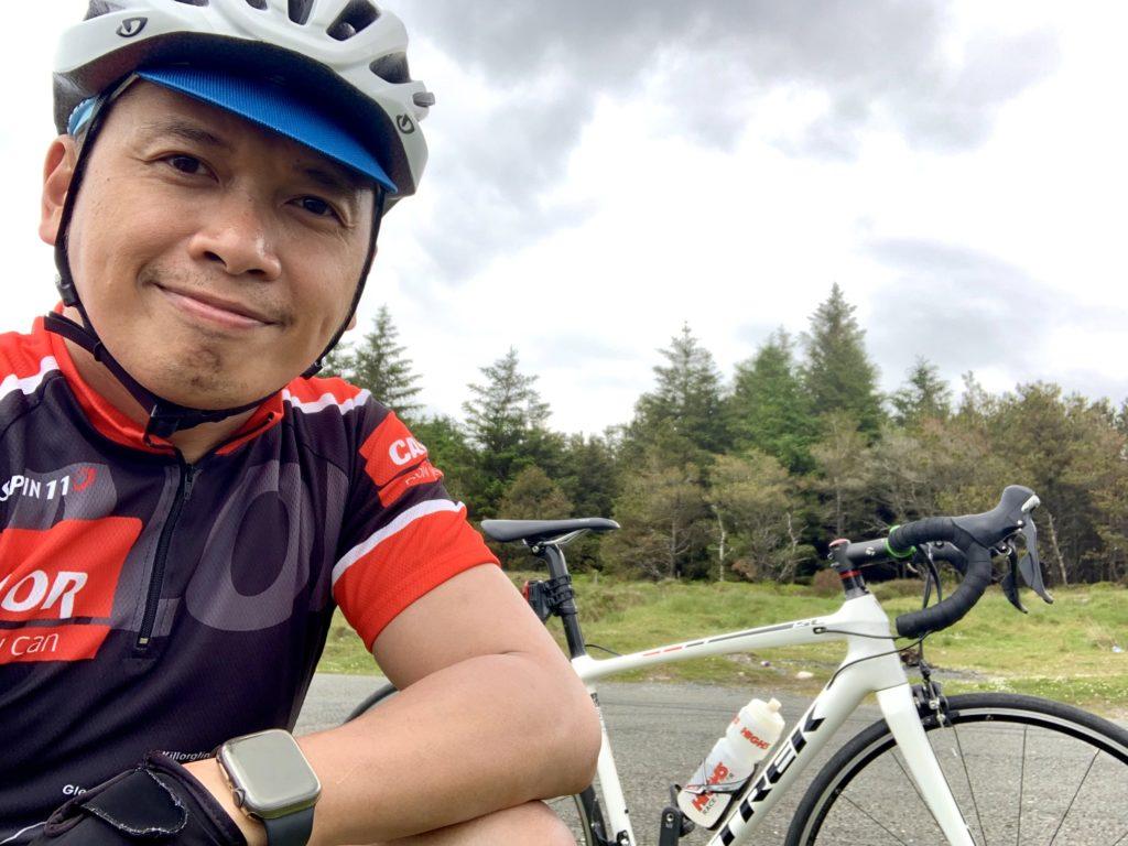 Reggie kneeling near his bike