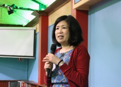 Sancha speaking at event