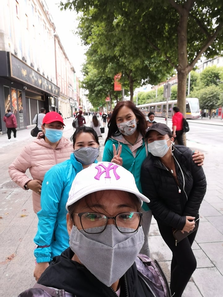 A group of women with masks on in Dublin on the last day of the fundraising challenge.