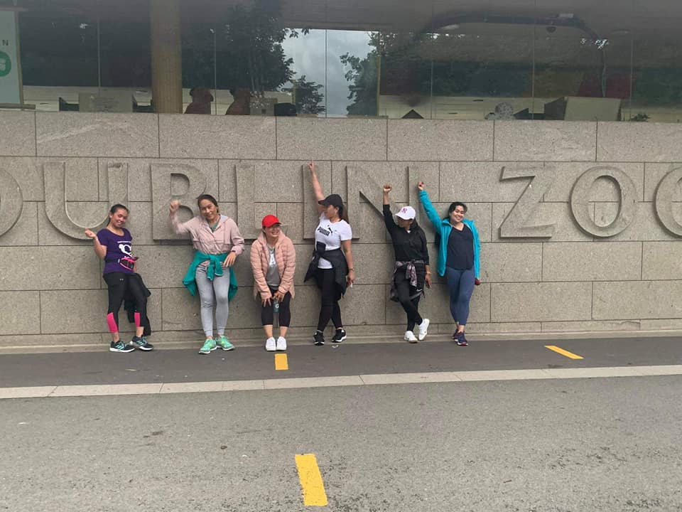 A group of women in front of Dublin zoo on the last day of their fundraising challenge.